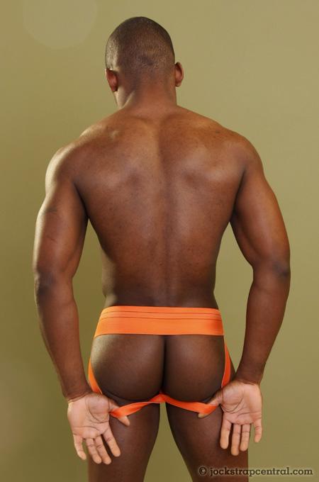 great ass in an orange safetgard jockstrap