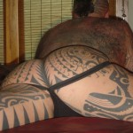 jockstrapped ass with tattoos
